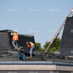 stock-photo-16996363-roofing-crew-at-work